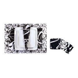 koi Design - Placemat Set - Midnight in the Garden - A mix of two contrasting black and white floral prints gives these place settings a striking, contemporary elegance. The set includes four cotton sateen placemats, four napkins with napkin rings, and eight coasters. They all come in a special matching pouch, which is great for storage but also makes this set a wonderful house-warming gift.