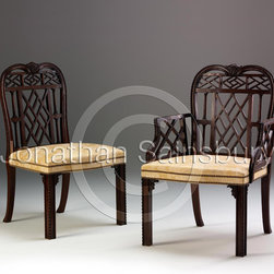 Chinese Chippendale Chair - A Chinese Chippendale design lattice back, column carved, and square leg dining chair.