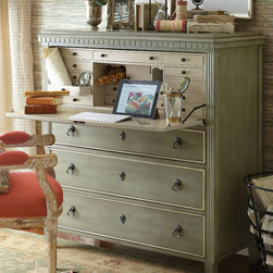 Bruges Secretary Desk - Inspired by a Belgian antique and faithfully re-created in its image, this beautiful and extremely functional secretary can serve as a convenient writing desk or elegant vanity. It easily does double duty as a desk and a bureau. An attractive pull-down panel in front conceals a wealth of drawers and cubbies in contrasting ivory. 3 generous drawers create opportunity for lots of storage. Solidly constructed of quality birch, Bruges is beautifully detailed with dentil moulding, fluted trim and antiqued brass hardware. Hand-painted in striated silver sage.