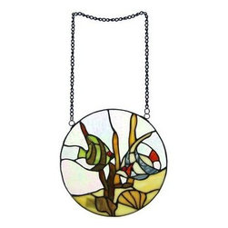 Stained Glass Window Panel - Tropical Fish - This beautiful leaded stained glass window panel adds a great whimsical accent to any room. Simply hang the panel in front of a window, using the 2 hanger rings, allowing the light to pass through the over 50 pieces of amber, green and red stained glass with round glass cabochons. This hanging features two tropical fish in an aquarium setting. Measuring 10 inches in diameter, the panel gives a look of playfulness to living rooms, kitchens and bedrooms. The panel is brand new, never used or displayed. It makes a great gift for friends and family. We have a very limited supply of these, so don't delay. Get yours now!