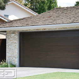 Dynamic Garage Door - Mid Century / Modern Style Garage Doors & Garden Gates in ECO-Friendly Materials - Modern garage doors designed and crafted by Dynamic Garage Door are architectural pieces that evoke authentic beauty to the style of your home. This custom designed and crafted garage door was constructed out of eco-friendly materials that will not leave an environmental footprint but rather an impression of awesomeness. We carefully design our doors to suit your home's character while our high end craftsmanship will ensure your garage doors and gates last a lifetime.