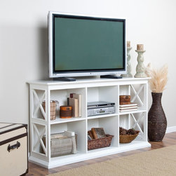 Belham Living - Belham Living Hampton Console TV Stand - White - DONU107 - Shop for Visual Centers and Stands from Hayneedle.com! Adding storage to your living room can be a tricky endeavor. You don't want a bulky cabinet that takes up a lot of space but you do need shelves for your media collection and components. Good thing your solution is right here - The Hampton Console TV Stand - White - a piece that combines storage and style in one conveniently sized package. It has two shelves which each feature three cubby compartments so you'll have enough room for DVDs CDs audio-visual components display items and more. Each compartment has a cord/wire management hole in the back so hooking up and moving electronics is so easy. At 32 inches high the spacious console top will give your TV an extra boost for optimal viewing. Constructed with a solid birch wood frame in a vibrant white finish this TV console has strong durable MDF shelves and compartment dividers in matching white finish. The sides of the unit have a modern X design that adds an artistic element to the table's sturdy structure. Assembly required. Dimensions Overall dimensions: 55.5W x 14.5D x 32H inches Compartment (each): 17W x 13.125D x 12.31H inches About Belham Living Belham Living builds catalog-quality furniture in traditional styles at a price that actually makes sense. By listening to our customers and working closely with great manufacturers we build beautiful pieces worthy of your home. Rich wood finishes attention to detail and stylish lines that tie everything together are some of the hallmarks of a Belham Living piece. From the living room or bedroom through the kitchen and out onto the deck there's something from an incredible Belham collection perfect for your style.