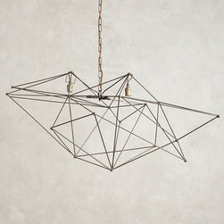 Iron Web Chandelier - Hand-welded iron rods intersect from every angle to form this modernist lighting sculpture, which is suspended from a vintage-inspired chain. We love the way its dynamic form and rustic style are instantly softened with the flick of a switch.