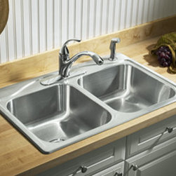 "Kohler - Kohler K-3145-4-NA Stainless Steel Cadence Cadence 33"" Double Basin - Product Features:Double basin sink with a 50/50 split provides increased versatility for any taskCovered under Kohler s limited lifetime warrantyThe Cadence stainless steel sink is a smart and stylish option for any kitchenTwo equally sized basins offer convenience for food prep and clean up tasksConstructed from 20-gauge stainless steel giving both the aesthetic beauty you want and the durability and longevity you needTop-mount installation makes for a quick and easy install wile keeping the elegant you craveCenter drain location provides optimal drainage capabilityAll hardware needed for installation includedProduct Technologies / Benefits:SilentShield : A sound-absorption system found in many Kohler sinks that significantly reduces the noise from clanging dishes and silverware, as well as undesirable noise caused by running water and disposals.Product Specifications:Height: 8-5/16"" (measured from the bottom of the sink to the top most point of the sink)Overall Width: 22"" (measured from the back outer rim to the front outer rim)Overall Length: 33"" (measured from the left outer rim to the right outer rim)Basin Width: 15-3/4"" (measured from the back inner rim to the front inner rim)Basin Length: 14-1/8"" (measured from the left inner rim to the right inner rim)Basin Depth: 8"" (measured from center of the basin to the rim)Installation Type: Top-mountNumber of Faucet Holes: 4Drain Outlet Connection: 3-3/4""Minimum Base Cabinet Width: 35""About Kohler:Gracious living is characterized by qualities of charm, good taste, generosity of spirit and the enhancement of nature. It is KohlerÂ's mission that you can improve your sense of gracious living with every experience you have with a Kohle"