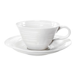 Portmeirion - Sophie Conran White Teacup and Saucer- 4pc set - 422179 - Shop for Drinkware from Hayneedle.com! Tea for two is fine for some but tea for four with the Sophie Conran White Teacup and Saucer- 4pc set is so much fun! Constructed of durable porcelain these 8-ounce teacups and 6-inch saucers are microwave- and dishwasher-safe. Their simple sturdy design is elegant enough for tea parties yet resilient enough for everyday use.About PortmeirionStrikingly beautiful eminently practical refreshingly affordable. These are the enduring values bequeathed to Portmeirion by its legendary co-founder and designer Susan Williams-Ellis. Her father architect Sir Clough Williams-Ellis was the designer of Portmeirion the North Wales village whose fanciful architecture has drawn tourists and artists from around the world (including the creators of the classic 1960s TV show The Prisoner). Inspired by her fine arts training and creation of ceramic gifts for the village's gift shop Susan Williams-Ellis (along with her husband Euan Cooper-Willis) founded Portmeirion Pottery in 1960. After 50+ years of innovation the Portmeirion Group is not only an icon of British design but also a testament to the extraordinarily creative life of Susan Williams-Ellis.The style of Portmeirion dinnerware and serveware is marked by a passion for both pottery manufacturing and trend-setting design. Beautiful tactile nature-inspired patterns are a defining quality of Portmeirion housewares from its world-renowned botanical designs modeled on antiquarian books to the breezy natural colors of its porcelain and earthenware. Today the Portmeirion Group's design legacy continues to evolve through iconic brands such as Spode the Pomona Classics collection and the award-winning collaboration of Sophie Conran for Portmeirion. Sophie Conran for Portmeirion:Successful collaborations have provided design inspiration throughout Sophie Conran's life. Her father designer Sir Terence Conran and mother food writer Caroline Conran have been the pillars of her eclectic mix of cooking writing and interior design. In pairing with the iconic British housewares brand Portmeirion Conran has created another successful collaboration: Sophie Conran for Portmeirion an award-winning collection of dinnerware serveware and drinkware for the practical multi-functional needs of contemporary kitchens.Launched in 2006 Sophie Conran for Portmeirion immediately received the Elle Deco Style Award for Best in Kitchens and two years later the House Beautiful Award for Best in Tableware. The soulful tactile beauty of these oven-to-tableware pieces is exemplified by rippled surfaces and edges that evoke a potter's hand. This down-to-earth style is complemented by charming pastels gentle earth tones and classic whites and pinks for a collection that will lighten and enliven contemporary kitchen decors. Though delicate to the eye and touch these plates and bowls are built for durable performance with microwave- and dishwasher-safe porcelain that's casual enough for breakfast and elegant enough for eye-catching dinners.