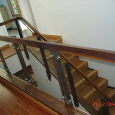 Contemporary Staircase by J Walsh Construction, Inc