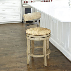 Ballard Designs - Marguerite Counter Stool - Our Marguerite Counter Stool is a stylish combination of rustic textures and fresh, updated design. The comfortable, hand rushed seat swivels a smooth 360 degrees. Frame is crafted of aged metal and contrasting hardwood with hand applied finish.Assembly required.