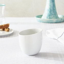 Como White Cup - Organic shapes in white porcelain dinnerware play neutral companions to the brilliant colors and expressive motifs of the Paola Navone tableware collection.