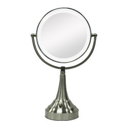 "Zadro - Round Vanity Mirror with LED Surround Light in Satin Nickel - The LED Lighted Round Vanity Mirror features a dual-sided, premium quality mirror with two magnifications. On one side, a 10x magnification mirror allows you to see up-close and in detail, allowing for easy make-up application. The other side features a normal, 1x magnification mirror that is great for checking hair and make-up. The vanity mirror lights up with energy-saving LED bulbs that illuminate your entire face, allowing you to see the finest details in even the dimmest lighting, and its cordless design allows you to place it anywhere! The LED Lighted Round Vanity Mirror is available in an elegant Satin Nickel finish. Features: -Vanity mirror. -Satin nickel finish. -Dual sided LED lighted mirror. -360 Degree Swivel Mirror. -10x - 1x Magnification. -Energy saving LED lighting consumes up to 70% less electricity than regular bulbs. -Round shape. -Operates on 4 ""C"" batteries or AC adapter (included). -Manufacturer provides 90 days warranty. Specifications: -Mirror surface dimensions: 7"" Diameter. -Overall Dimensions: 18"" Height x 11"" Width x 5.5"" Depth."