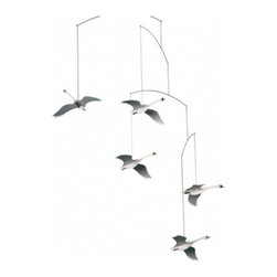 Flensted Mobiles - Scandinavian Swan Mobile - This meaningful mobile's creator chose five elegant and majestic swans to symbolize the five Scandinavian countries. It serves as a stylish, contemporary addition to your new arrival's nursery, or a thoughtful gift to the newly expectant mother.\