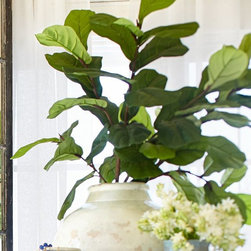 Faux Oversize Fig Branch - If real plants aren't your thing, how about a realistic-looking branch in a vase to bring the outdoors in? Display several of these popular fiddle leaf fig branches and nobody will be the wiser. Or put them in a vase to add volume behind existing smaller plants.