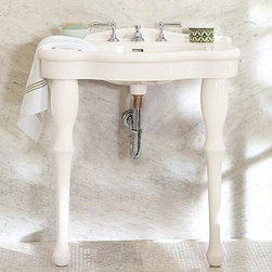 "Parisian Pedestal Single Sink Console - Cast of creamy white porcelain with fluid curves and rounded edges, our console resembles fixtures in 1920s Paris apartments. Perfectly scaled for smaller spaces, it stands on two turned legs and has an integral sink and top with just enough room for essentials. 32"" wide x 21"" deep x 35"" high. Expertly crafted of porcelain. Top is pre-drilled for an 8"" widespread faucet. Features a stylized mini backsplash and legs that are rounded for a lathe-turned look. Use with any of our faucet collections (sold separately). Professional installation required. {{link path='pages/popups/install_parisian_popup.html' class='popup' width='720' height='350'}}Learn more{{/link}} about how to install this sink console. View our {{link path='pages/popups/fb-bath.html' class='popup' width='480' height='300'}}Furniture Brochure{{/link}}."