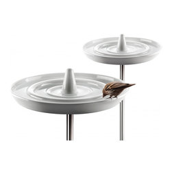 Eva Solo Bird Bath - This bird bath has a beautiful design of concentric circles. The glazed porcelain is supposed to be frost proof so the bath can stay out when starts to get colder. I like that it's delicate enough to set this in the middle of a flower bed and not take away from the flowers.