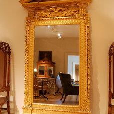 A George II Kentian carved giltwood mirror. Circa 1730. at 1stdibs