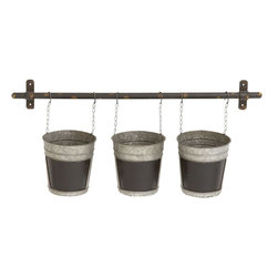 "Benzara - Classy and Trendy Metal Wall Planter - This is specially designed for all your garden lovers. Made from metal, this one of a kind wall planter features three buckets and a rod. The sturdy rod, dyed in shade of black, can be used to place on any wall. The three buckets features metal chains and hooks so that it can be dangled from the rod. This metal planter can be used indoors or outdoors. An unique way indeed to spruce up your home and garden, this planter is assured to capture your guests attention whenever they come visiting you and make them go wow at its sight.This metal planter is easy to clean and you can replace the plants from the buckets by taking it off the rod and placing it back. This wall planter can be an excellent choice to present your family or friends with gardening hobbies. So get one now. This wall planter measures 28 inch (W) x 6 inch (D) x 11 inch (H) and measures 6 inch (W) x 6 inch (D) x 6.5 inch (H) bucket; Made from metal; Set of 3 buckets and a rod; Dimensions: 29""L x 8""W x 8""H"