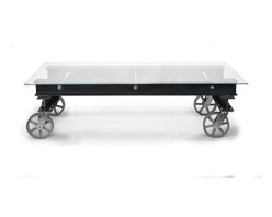 """Real Industrial Edge Furniture - -Justin Real- Industrial I-Beam Coffee Table with Glass Top - This coffee table is seriously heavy duty and meant to be. It is constructed from structural I beams topped with 1/4"""" glass and finished with cast iron casters. The I-beams were sandblasted clean and then clear coated to protect the steel. It is 5 feet long, 2 feet deep and 18 inches high.  It is the perfect modern industrial statement piece."""