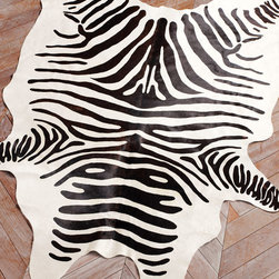 Zebra Hide Rug - These stenciled hide carpets come in a variety of colors and no two are alike. I love when these are layered with more classic carpets for a contrast in pattern and shape.