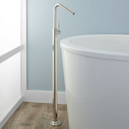 Cavalier Freestanding Tub Faucet - With smooth arched neck, the Cavalier Freestanding Tub Faucet adds a clean silhouette appeal to a modern tub. Crafted of solid brass, this tub filler is mounted to the floor and features a single-handle valve.