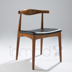 Wegner Elbow Chair - The Wegner Style Elbow Chair is a high quality reproduction of Hans Wegner's CH20 Elbow Chair. The Wegner Style Elbow Chair clearly illustrates Wegner's unique understanding of wood and its possibilities. This simple and elegant chair is true to Wenger's quest for simplicity in design. With impeccable accuracy and attention to detail, our Wegner Elbow Chair brings a recognized and respected look into your home at an affordable price.