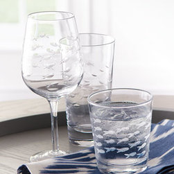 Horchow - Four Etched Fish Wine Glasses - Perfectly charming, this clear glassware is etched with a distinctive fish design to add nautical flair to the table. Made of clear glass. Hand wash. Wine glasses hold 13.5 ounces. Double old-fashioneds hold 12 ounces. Highballs hold 15 ounces. I...