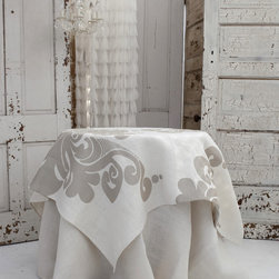 Couture Dreams Enchantique Ivory/Sand Table Topper - Couture Dreams Enchantique Jute Table Toppers are what we like to call a French inspired Art Deco with a Modern Twist. Truly beautiful and unique these rustic chic jute table toppers are each hand printed with a large decorative motif. Offered in three different colorways, these table linens are sure to dress up any table. These table linens can be combined with any type of home decor from modern to traditional. They are made from fine, premium quality 100% all natural jute fabric which puts a fun and funky spin on traditional table linens.