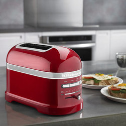 """Frontgate - KitchenAid Pro Line Series 2 Slice Toaster - Auto Keep Warm feature activates after toasting cycle, keeping your bread warm for up to three minutes. """"A Little Longer"""" button allows you to toasts one shade darker if you decide your chosen setting wasn't dark enough. Automatic sensors lower your bread when it's inserted and raise it when it's ready. Extra-wide slots accommodate bagels and thick-sliced breads. Includes defrost function for frozen breads. Before the KitchenAid Pro Line Series Two Slice Automatic Toaster, you probably never thought a toaster could be this gorgeous – or this versatile. This unit offers a host of toasting features. Select from four preset toasting functions and use a sliding scale to pick exactly how light or dark you want your toast.  .  .  .  .  . Lights above the browner setting indicate what toasting level you've selected . Five-year limited manufacturer's warranty . UL listed . 54"""" cord ."""