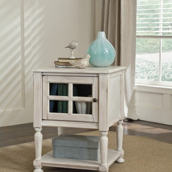 Coastal/Tropical/Cottage - Ashley Furniture's Cottage Accents chair side end table is made with select veneer and hardwood solids. Each piece is finished in a gently distressed vintage painted finish. Each piece is moderately scaled and selected for its versatility of use in the home. Doors and drawers have simple bronze color metal decorative knobs. (ashT505-102)