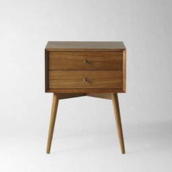 Mid-Century Nightstand - Acorn | West Elm - Simple, sophisticated storage. Inspired by mid-century design, the Mid-Century Nightstand borrows its slim legs, angled face and understated retro details from iconic '50s and '60s furniture silhouettes. Antique-bronze-finish knobs on the drawers provide an unexpectedly luxe twist to the clean-lined silhouette.
