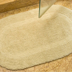 Safavieh - Spa Collection Cream Reversible 2400-Gram Bath Mats (Set of 2) - Turn any bathroom into a spa with an ultra luxurious extra dense bath rug Oval-shape bath rugs measure 25 inches x 45 inches Rugs are reversible and identical on both sides