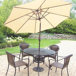 Oakland Living - 7-Pc Outdoor Dining Set - Includes one dining table, four stackable resin wicker chairs and 9 ft. tilt crank umbrella with stand and metal hardware. Handcast. Traditional lattice pattern and scroll work. Fade, chip and crack resistant. Umbrella hole table top. Hardened powder coat. Warranty: One year limited. Made from rust free aluminum, steel and resin wicker. Black color. Minimal assembly required. Chair: 23.25 in. W x 25.5 in. D x 34 in. H (14 lbs.). Table: 48 in. Dia. x 29 in. H. Overall weight: 155 lbs.This dining set is the prefect piece for any outdoor dinner setting. Just the right size for any backyard or patio. The Oakland Tuscany Collection combines contemporary style and modern designs giving you a rich addition to any outdoor setting.