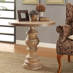 None - Latte Pedestal Table - Made of turned wood in taupe tones the Latte Pedestal Table offers an elegant milkwash finish. This pedestal table will is constructed out of Chinese hardwood and will add a soft and stylish accent to any space.