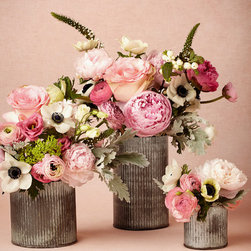 Ridged Tin Vases - Tin is a metal not often used, but it looks gorgeous adorning these simple vases.