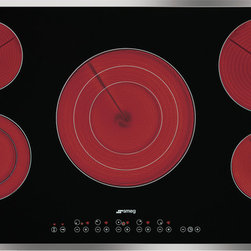 "S2951CXU - 36"" CERAMIC COOKTOP WITH STAINLESS STEEL FRAME. BLACK GLASS ""SUPREMA"" WITH SOFT TOUCH CONTROLS AND 5 HIGH LIGHT RADIANT ELEMENTS. ONE VARIBLE CENTRAL BURNER WITH 3 ADJUSTMENT LEVELS."