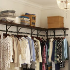 New York Shelf and Clothes Rack - I really need to have these New York–style closet shelves in my laundry room. I love the mix of the wood shelf and the metal bar. They would take a laundry room from drab to fab.