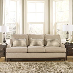 Signature Design by Ashley - Signature Design by Ashley Donella Barley Sofa - This traditional three-seat sofa features a charming retro design with low-profile arms and a square frame. Upholstered in neutral barley-tone fabric,this sturdy sofa offers the luxury of a comfortable seat with classic styling to complement your decor.