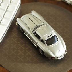 "Mercedes Benz 300 SI Wireless Mouse - Next time someone says ""won'tchabuyme, a Mercedes Benz"", say yes and give them this stylish wireless mouse.Modeled after the Mercedes Benz 300 SLCompatible with PC and Mac.Includes rechargeable batteries and a charging station.5.5"" long x 2.5"" wide x 2"" high"