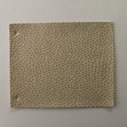 Reina 2130 Beige Faux Leather for Upholstery and Interior Design by FFC - Tough and durable, the Reina 2130 is a superior choice for any project. The polyester nonwoven backing adds strength to this easy-to-work-with fabric. The 2130 comes in a neutral beige color with an interesting texture that is simple to clean and doesn't easily fade over time.