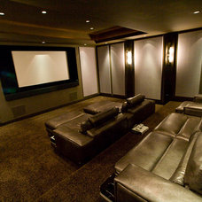 Modern Home Theater by Iron Mountain Remodeling