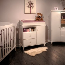 South Shore Moonlight Changing Table - A stylish piece that will grow with your baby girl this South Shore Moonlight Changing Table is a transitional beauty. Well-crafted and designed to last this changing table is crafted of durable engineered wood and comes in your choice of finish. Drop-ring hardware and turned bun feet add panache. The changing table on top has a front panel for extra safety and is removable when baby gets older. An open cubby offers a space for easy-access baby essentials now and a treasure box when she's older. A door gives you space to tuck away items. Two drawers operate on metal guides for smooth opening. About South Shore FurnitureA recognized leader in North American furniture manufacture South Shore Industries was established in 1940 and has been making furniture for three generations. Employing a team of over 1 000 employees in three factories in Quebec their assembled and ready-to-assemble furniture has a reputation for quality and excellence at affordable prices for today's family. A Green ChoiceAll South Shore Industries products are made of laminated engineered wood which gives them great strength and durability. Wood panels are made entirely from recovered and recycled material. While South Shore makes every effort to preserve the environment by conserving our forests they make no compromise when it comes to quality and product durability. Their products are designed for easy maintenance and offered at very competitive prices.