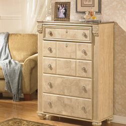 Signature Design by Ashley - Signature Designs by Ashley 'Saveaha' Light Beige 5-drawer Chest - Intricate details and beautifully carved knobs add style and class to this beautiful dresser from Signature Designs by Ashley. With roomy drawers and a versatile finish,this wooden dresser is the perfect addition to your room decor.