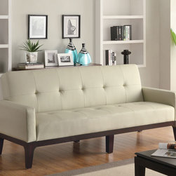 Coaster - Cream Contemporary Sofa Bed - This casual styled sofa bed is covered in a durable leather-like crme vinyl. Padded track arms and button tufted seating add to the casual styling. Exposed wood base is finishe din cappuccino.