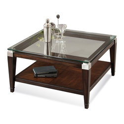 Bassett Mirror - Dunhill Square Cocktail Table - This handsome cocktail table is topped off with a scratch-resistant glass top featuring polished edges. Satin nickel corners add visual interest along with the parquet-patterned oak shelf underneath.