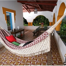 Island Bay - XL Wine Jacquard Handwoven Brazilian Hammock Multicolor - 105SJJAQUARDWINE - Shop for Hammocks from Hayneedle.com! Additional features Hanging hardware not included Weight capacity: 400 lbs. Overall length: 13 ft. 9 in. Hanging distance min/max: 9 ft. 2 in./13 ft. 9 in. Feel free to rock the day away while drinking a nice glass of wine in the XL Wine Jacquard Print Brazilian Hammock. Meant for a large open space this oversized hammock looks like it came right out of a travel magazine. It is authentically hand-woven by talented artists in Brazil from comfortable cotton in a geometric wine red jacquard print. Up to three people can swing in this extra-large backyard hammock. Ready to wrap you up like a blanket this hammock has a white rope fringe hanging from the sides for a unique style element. About Ramalho TextilesCombining old-style quality with innovation Ramalho Textiles is one of the original pioneers of hammock construction in Brazil. Founded in 1944 Ramalho Textiles has stayed at the forefront of the market. Their goal is to spread and preserve the tradition of the hammock in Brazil and the world.