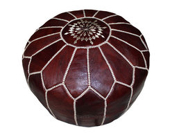 Moroccan Leather Pouf Brown - Soothing and sophisticated, the Brown Moroccan Leather Pouf is a fun way to spruce up a room with a touch of shine and sparkle. Hand-stitched Moroccan leather poufs make a great ottoman/foot stool. Little ones enjoy them as a seat that's just their size. Enjoy the versatility and color of this classic decor accessory in your home