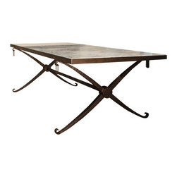 Lauren Lozano Ziol - French 40's style X Base Dining Table - X most definitely marks the spot for style. This sleek yet exciting dining table by designer Lauren Lozano Ziol weds a forged metal base to a limestone top for a look that's elegant yet welcoming.