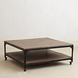 "Anthropologie - Large Decker Coffee Table - Caster legsOne shelfMango wood, iron18""H, 44""W, 44""DImported"