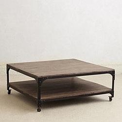 "Anthropologie - Large Decker Coffee Table - Caster legsOne shelfMango wood, iron18""H, 44""W, 44""DImported"