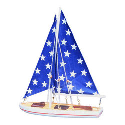 Handcrafted Nautical Decor - It Floats 12'' - Big Stars Floating Sailboat - NOT A MODEL SHIP KIT --Attach Sails and the It Floats Sailboat is Ready for Immediate Display and Use-- --Our new It Floats - Big Stars   model salboat   is freshly designed with increased  craftsmanship and is   our debut  float alone sailboat. Available in 9  different  styles/colors,  this sailboat can  be taken into the water and  enjoyed  by anyone.  Included with your  purchase is a wooden base to   prominently display the  model after use.  These sleek and elegant   wooden  model sailboats have  seen careful  attention paid to every   detail. Bring a  winning spirit  and nautical  flair to the Decor of any   room with the  clean lines and  graceful  features of these model   sailing boats. Attaching sails is a simple process typically taking no more than 2 minutes.------    Handcrafted from solid wood by our master artisans--    Patriotic red, white stars and blue colors used to accent sail boat--    Wooden base included with sailboat to prominently display model--    Our functional floating sailboat is waterproof. IT FLOATS!--    Suits any room or decor with clean lines and simple colors--