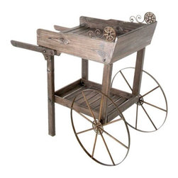 Wooden Rolling Garden Potting Cart - This potting cart looks like a planned piece of outdoor furniture while providing the convenience of a rolling cart. I love the distressed wood and the antique looking wheels.