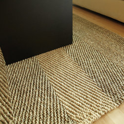 Sahara Jute Rug - Jute brings a magnificent, chunky texture to any space. These rugs are expertly handloom-woven by skilled weavers who employ a variety of traditional techniques to create these simply beautiful styles. Jute fibers exhibit naturally anti-static, insulating and moisture regulating properties. It is predominantly farmed by approximately four million small farmers in India and Bangladesh and supports hundreds of thousands of workers in jute manufacturing (from raw material to yarn and finished products). Multi jute yarn in herringbone weave.